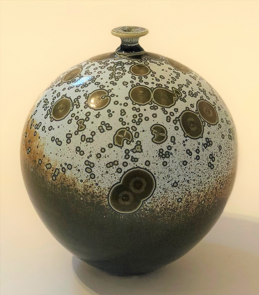 Ted Secombe 49.  Bottle - Native Landscape , 2018, porcelain, white gloss crystalline glaze on bronze, H19 x W16cm
