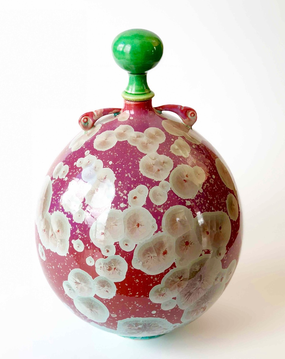 Ted Secombe, 64.  Stoppered Bottle,  2018, porcelain, cerise crystalline glaze with green stopper, bird skull lugs, H37 x W25cm