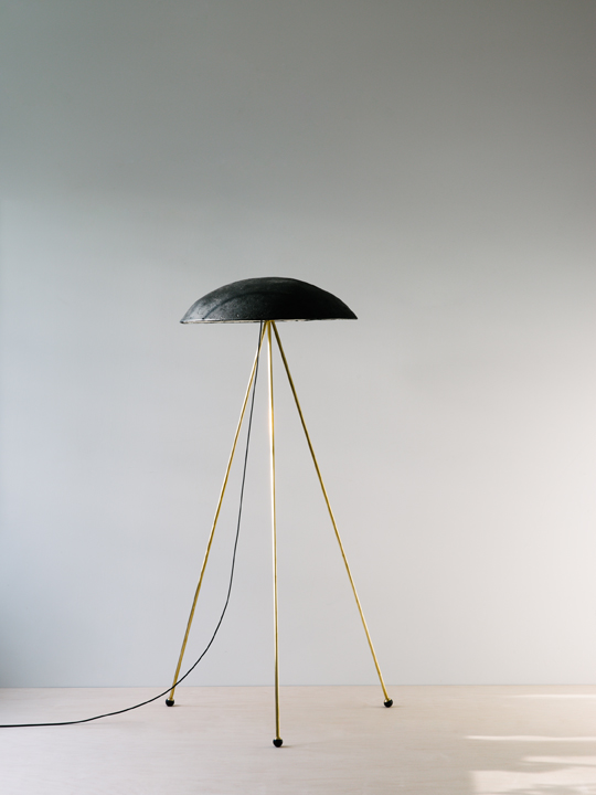 "- tall buddy floor lampThe Tall Buddy Floor Lamp is more staid than the Funny Buddy Floor Lamp, with an unmoving noggin 21"" in diameter set onto three 46"" brass legs with rubber-dipped ball feet. Shades come in black, white, terracotta, or grey.Lead time: 7-8 weeks"