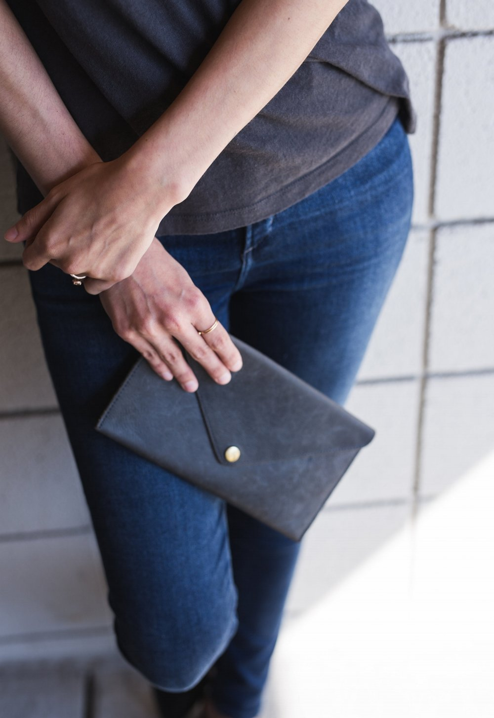 Unfortunately, this wallet is no longer available but the Luisa clutch in Indigo has a similar feel and is the same color.
