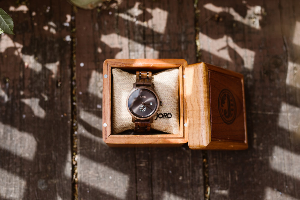 Pictured:  Hyde series walnut and black watch