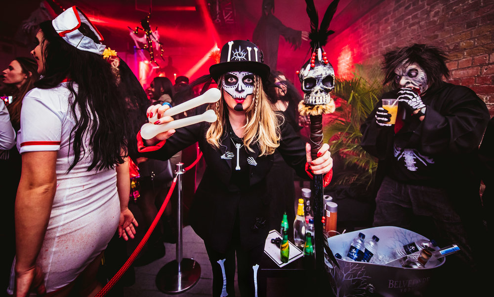 Try your own version of a Voodoo-inspired costume, with skeleton leggings, a black top, a DIY card bone necklace, DIY card bones stapled on a hat, plus black and white face paint!