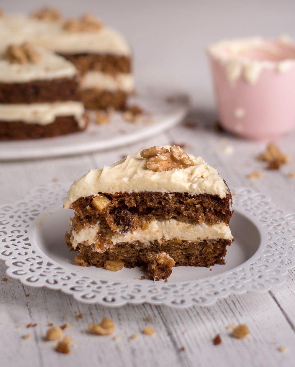 Classic Carrot Cake with a Cream Cheese Icing and Shelled Walnuts.