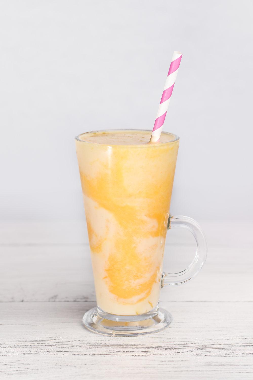 Mango, Pineapple, Banana and Orange Smoothie.