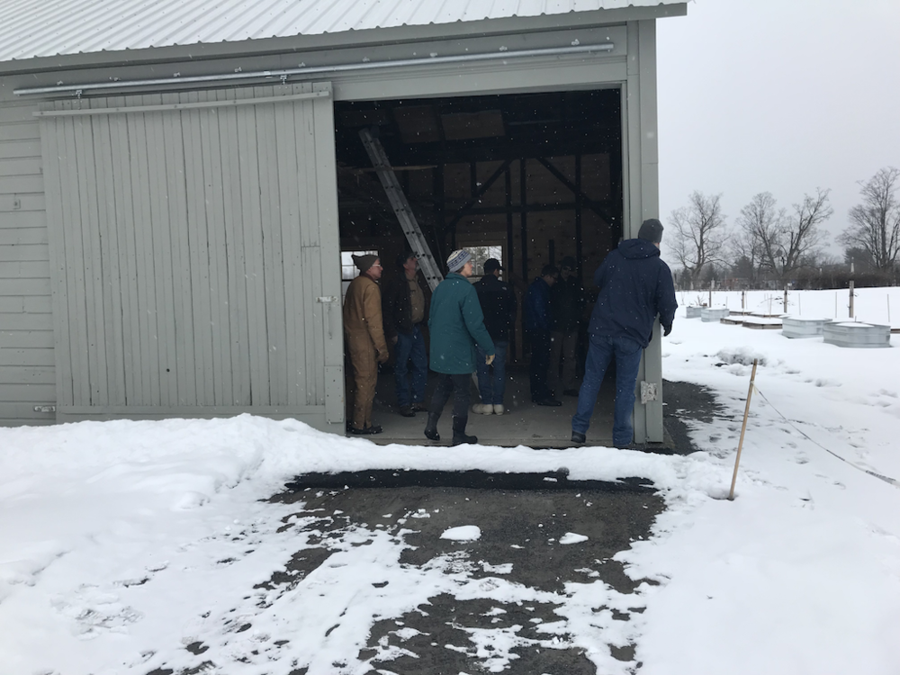 Members of the Agricultural Committee get a farm tour. Here they are in Bill's Gathering Barn that was renovated in 2017 by volunteers; It was originally the Slaughter House on the Pitney Farm.
