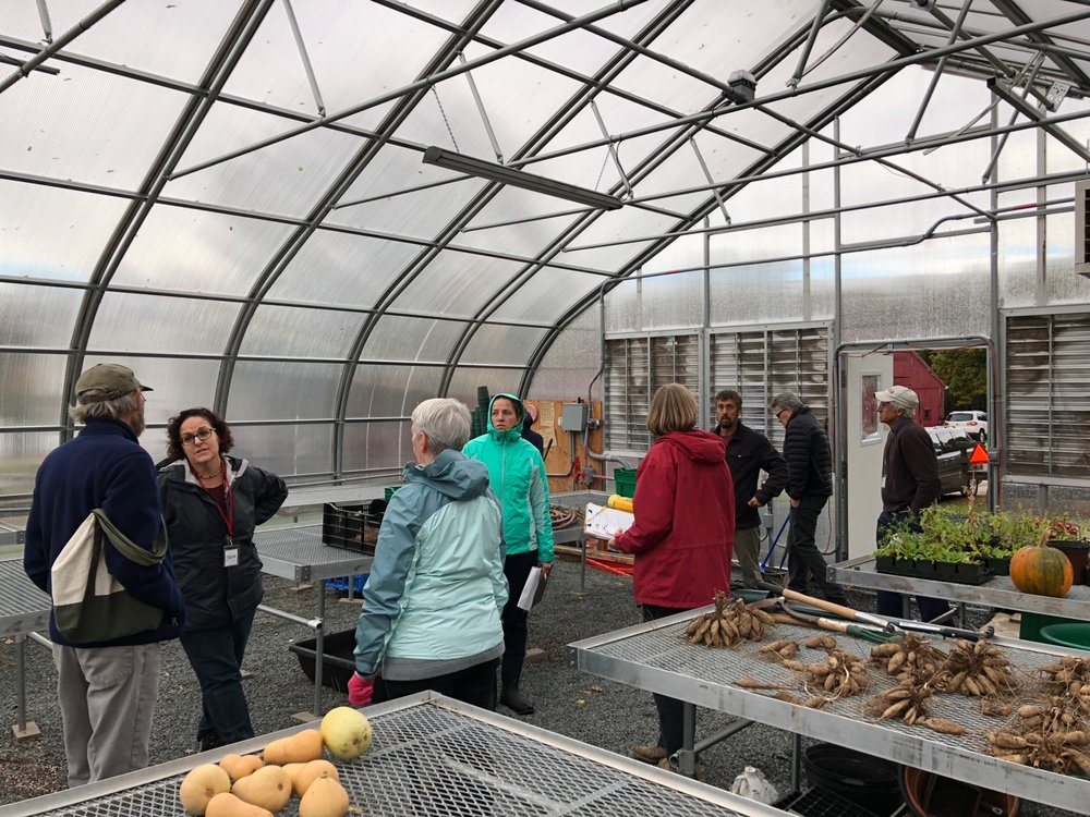 The PMCF Team touring the new greenhouse at the Community Farm of Simsbury, CT