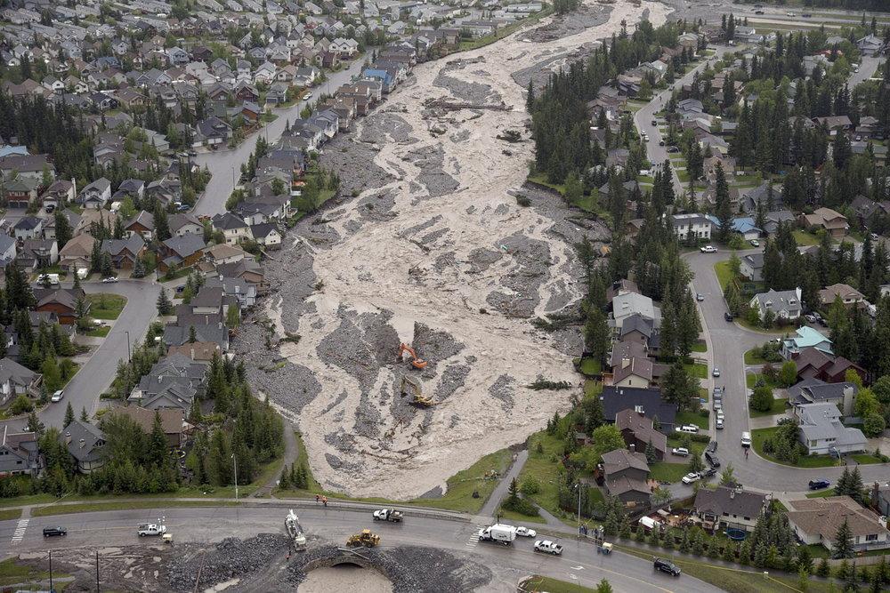 Figure 2.  Cougar Creek following June 2013 flood event. (Photo credit: The Canadian Press, Jonathan Hayward)
