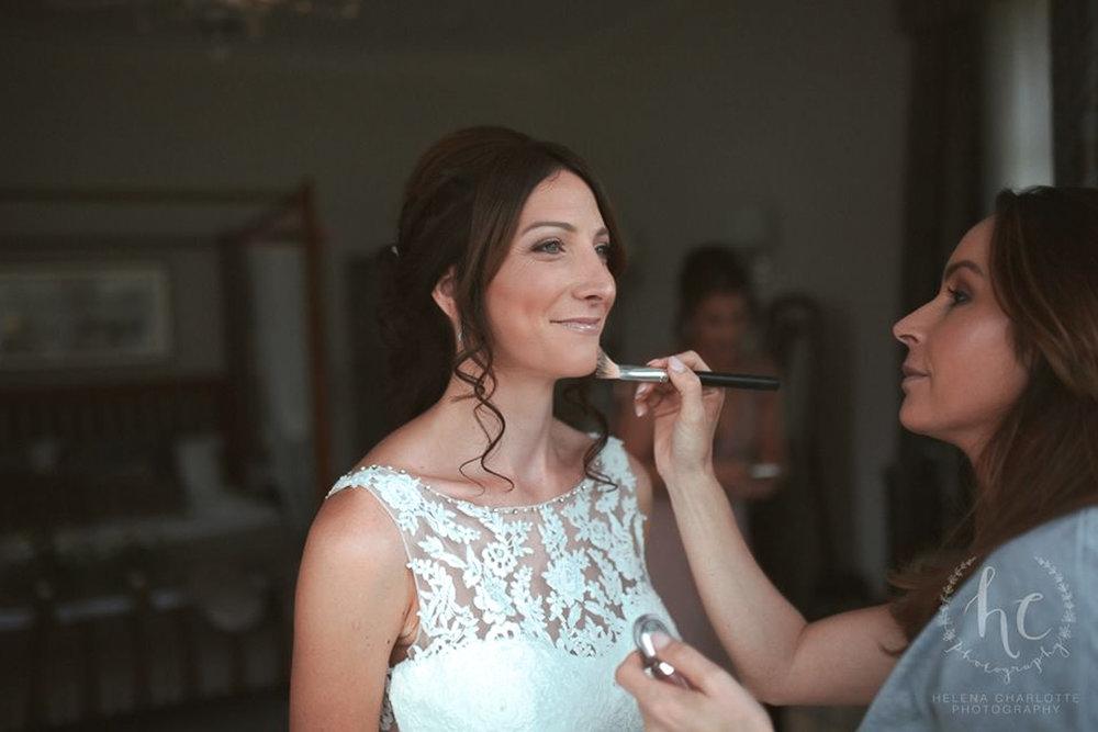 Wedding makeup artist making a make up for bride.jpg