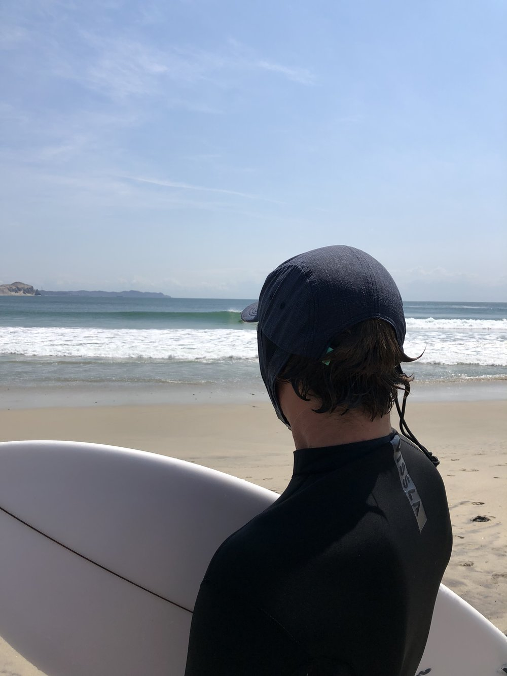 EG mind surfing. Would his brain be functioning as well without the shade provided by the hat ?