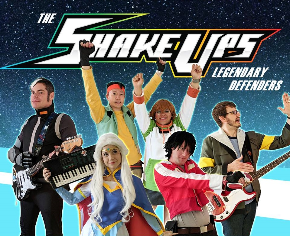 The Shake Ups - The Shake Ups are an award-winning, Indianapolis-based rock band that combines infectious power-pop tunes with cosplay and a multimedia presentation for a pop culture-fueled concert experience like no other! The band's latest original project, Legendary Defenders, is a tribute to the sci-fi/fantasy classic, Voltron!The Shake Ups have performed at conventions across the U.S. for audiences of all ages. The band's live repertoire includes songs from and inspired by a variety of animated series, such as Steven Universe, Teen Titans, My Little Pony, The Powerpuff Girls, Sailor Moon, Teenage Mutant Ninja Turtles, and more.The Shake Ups are professional crowd pleasers and the galaxy's most animated band!