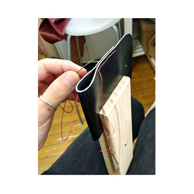 Putting new ideas to the test in the studio this week. #ideas #test #newideas #leather #hands  #handmadeaccessories #leatherworkshop #leatheraccessories #accessories #accessorydesign #black #red #stitch #linen