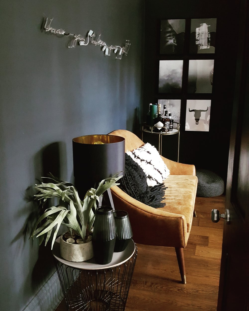 Fabulous faux foliage from  Abigail Ahern  sitting pretty on top of a  Rockett St George  coffee table alongside leather sofa from and cushions from  Rose & Grey