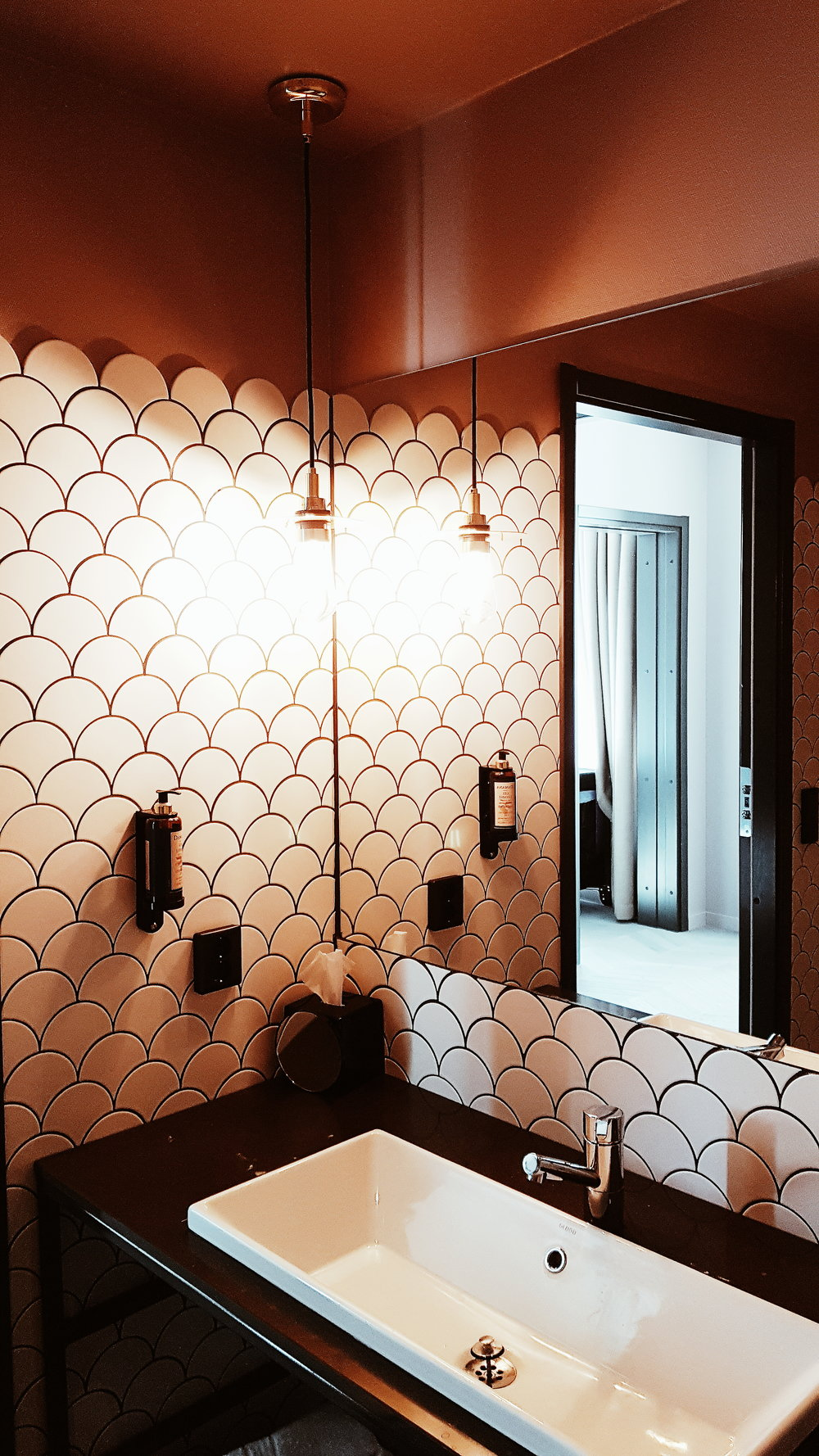 The bathroom made me go home wanting to scallop tile something!