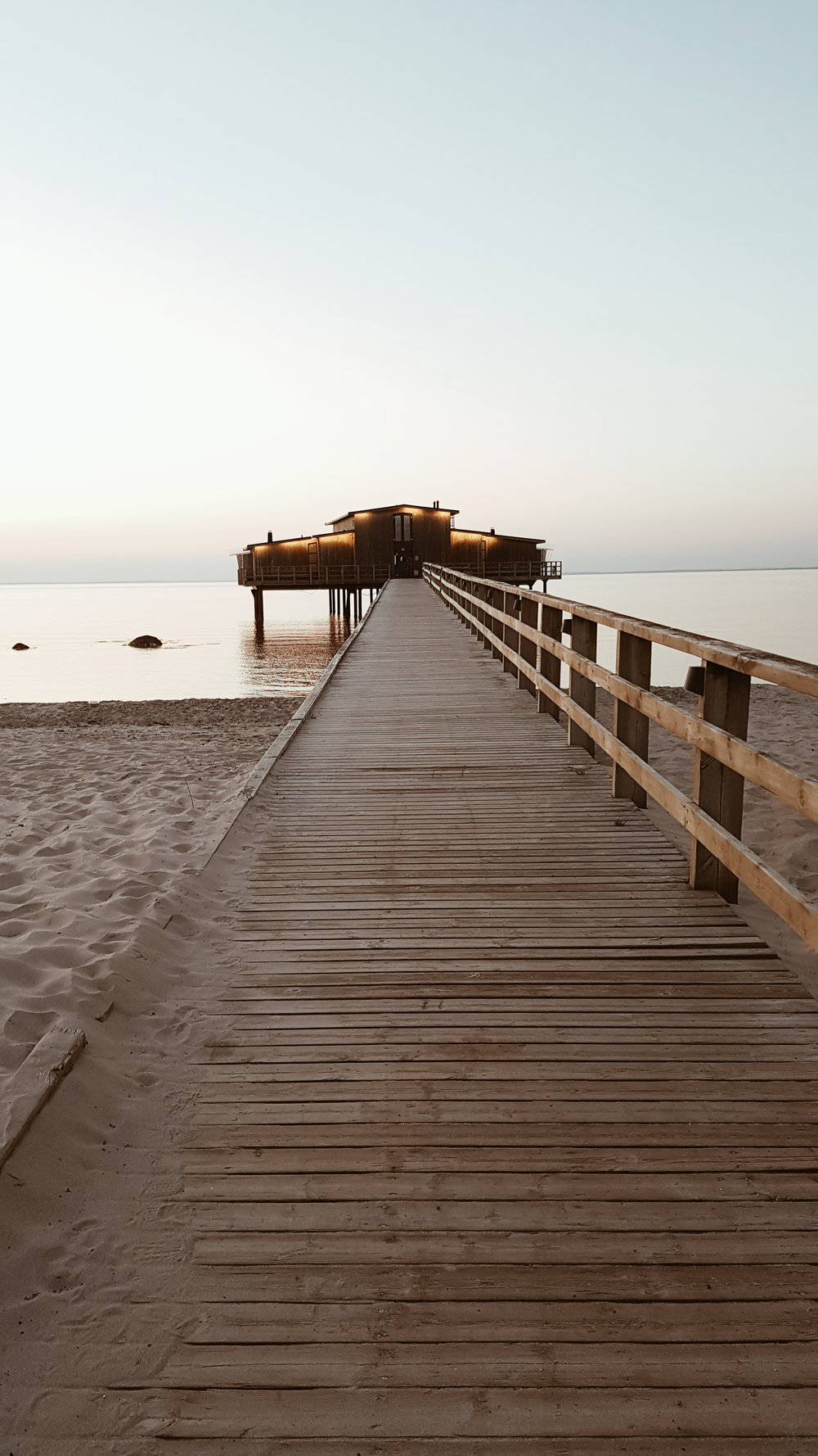 The stunning beach that Hotel Skansen overlooks and the sauna at the end of the pier for use by hotel residents