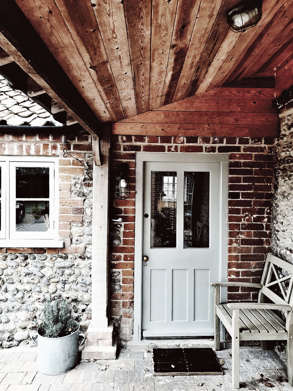 The gorgeous back porch of  Eden Hall Cottage  which is a traditional flint cottage on the North Norfolk coast