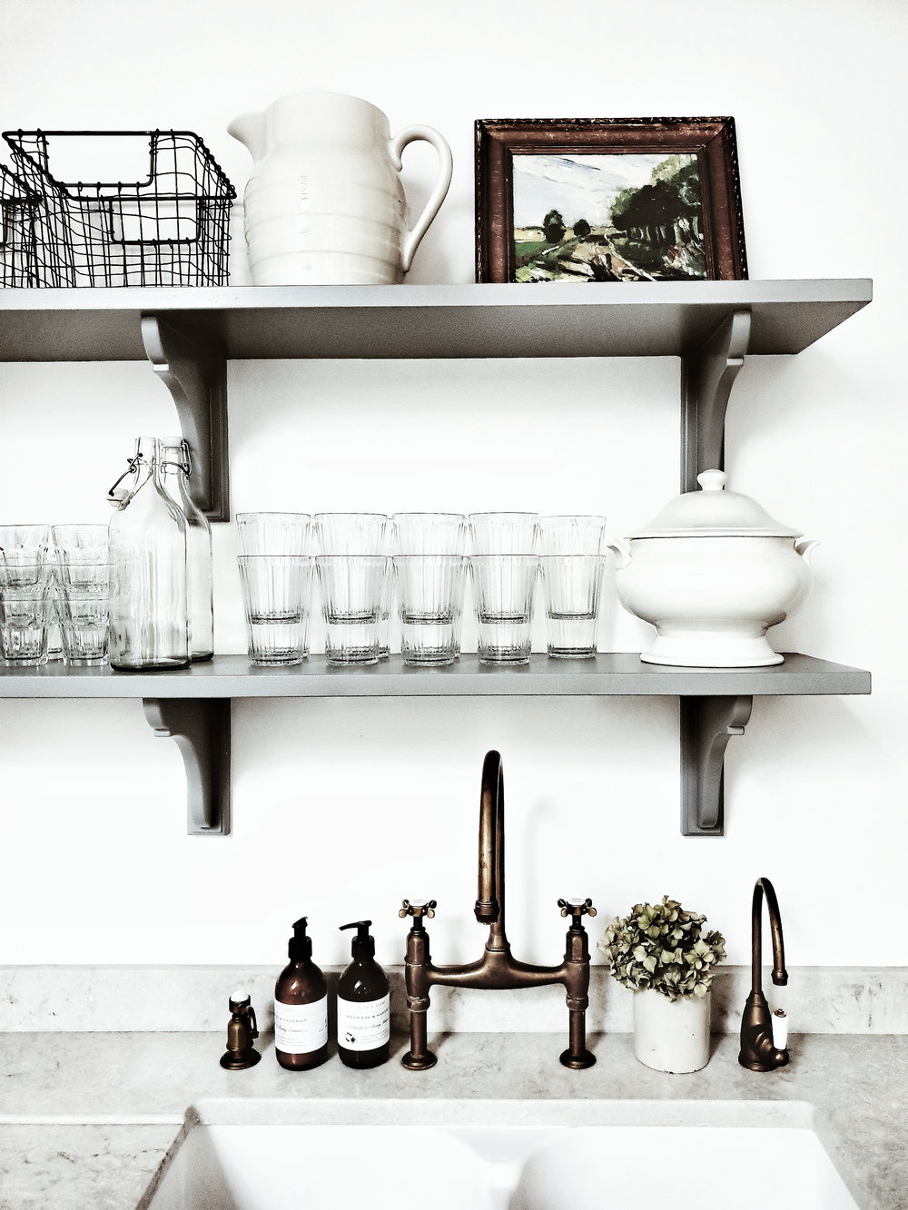 Marble worktops and brass taps add a vintage edge to the