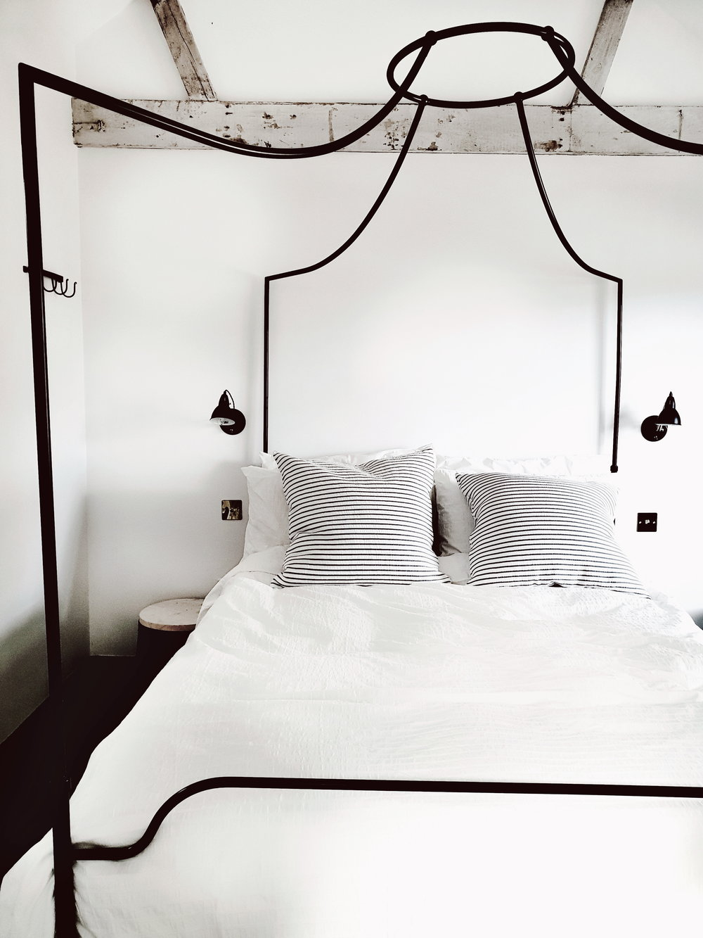 The four poster bed of my dreams from the White Company in the master bedroom