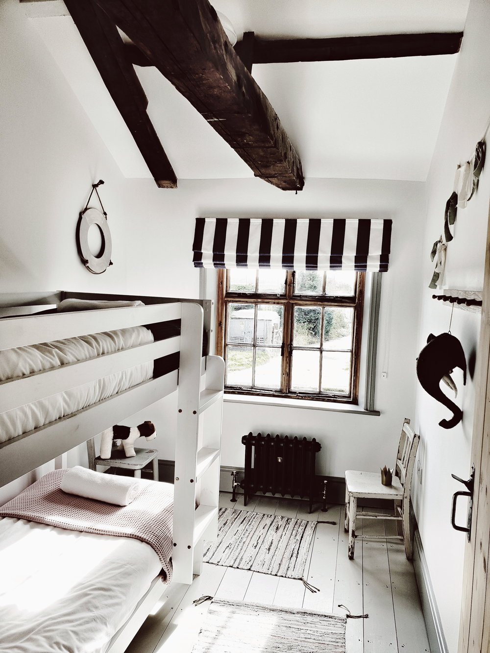 The lovely single bedroom complete with bunk beds and lots of thoughtful touches for junior guests