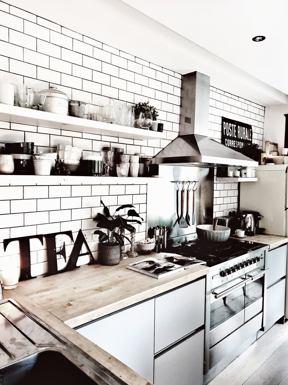 My scandinavian kitchen with grey kitchen units, open shelving and metro tiles on the wall. It is a light, contemporary kitchen with modern rustic feel #modernrustic #contemporarykitchen #greykitchen #kitchenideas #kitchendesign