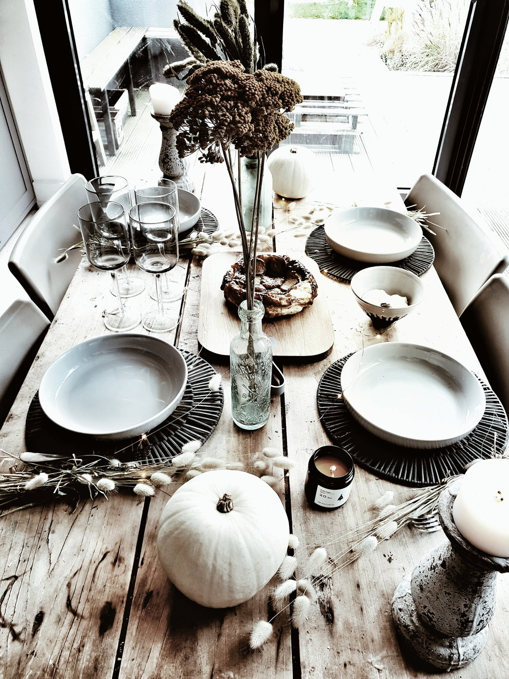 White pumpkins adding a modern rustic touch to the table