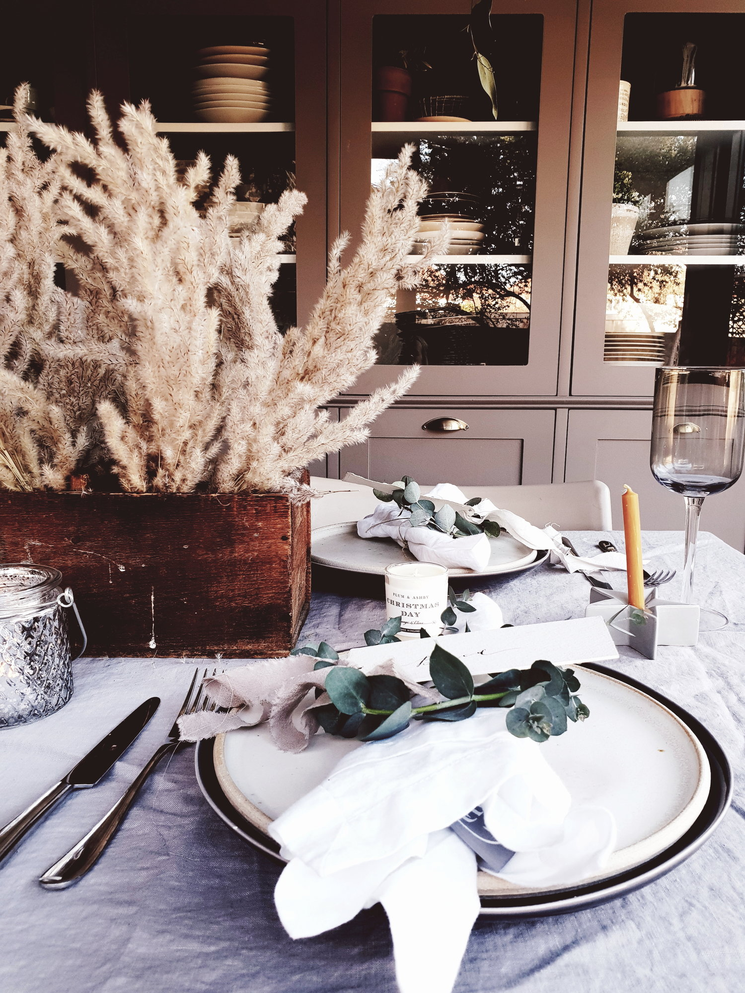 The wooden box adds warmth and texture to the Christmas table