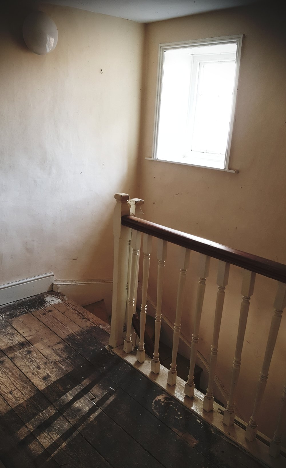 The upstairs landing and staircase. The entire upper floor had to be removed as part of the renovation and replaced after the joists were found to be rotten