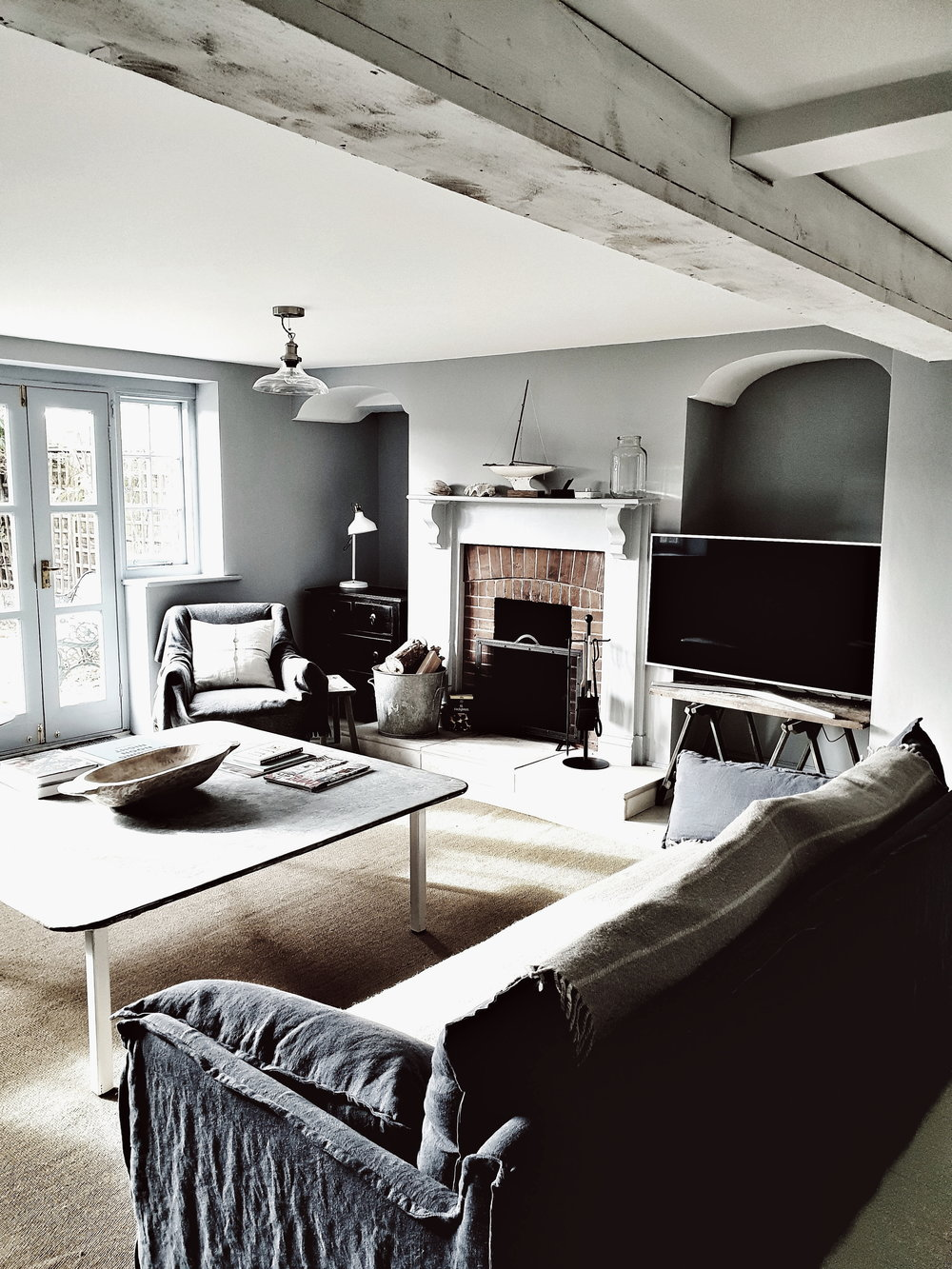 The living room with open fire and that zinc coffee table!