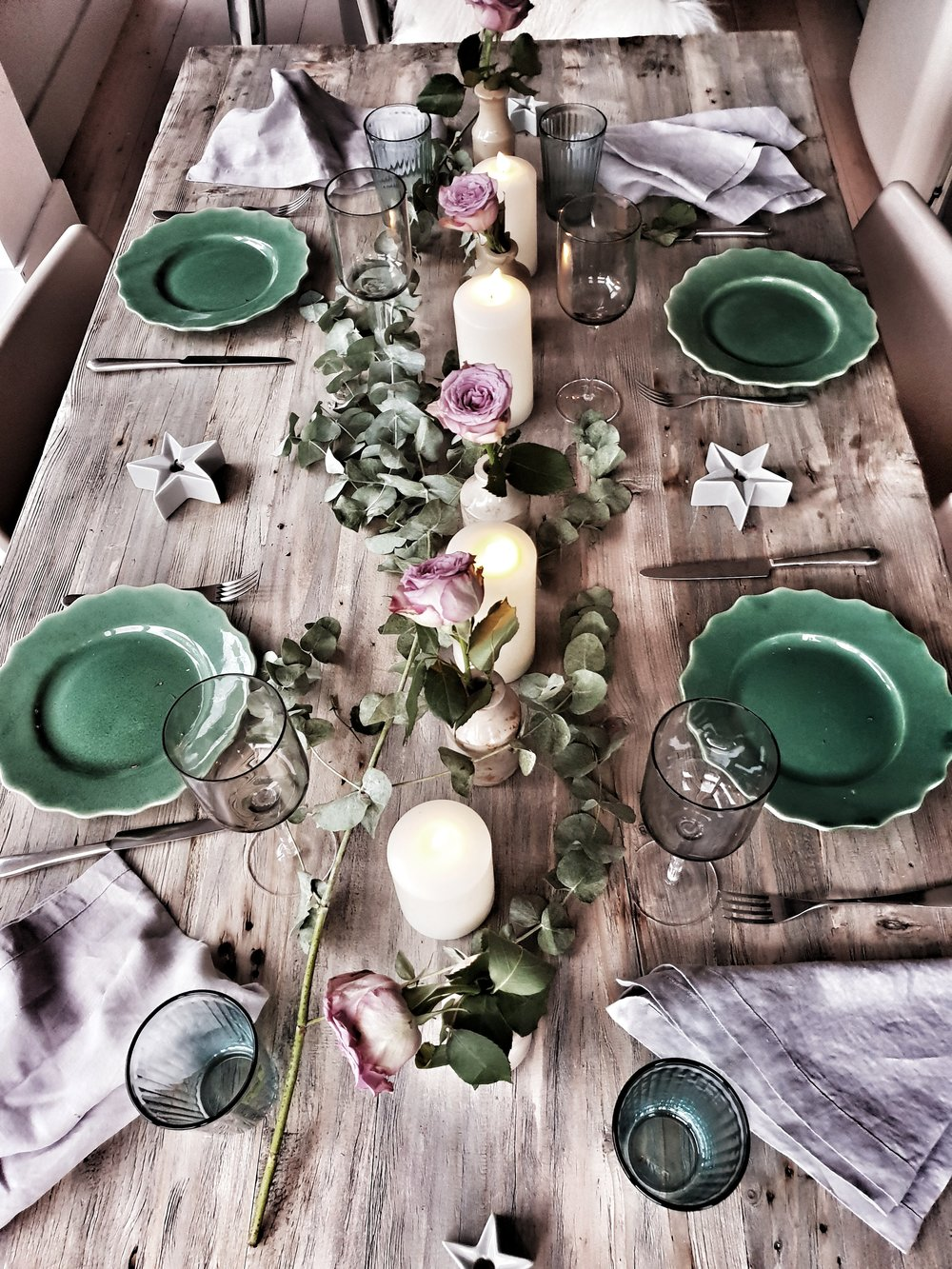 Eucalyptus down the centre of the table makes an inexpensive and lovely smelling garland