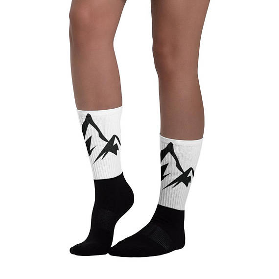 Mountain Socks - $17.00These socks are extra comfortable thanks to their cushioned bottom. The foot is black with artwork printed along the leg with crisp, bold colors that won't fade. • 60% nylon/22% cotton/18% spandex• Crew length• Cushioned bottom• Ribbed leg• Cold wash with like colors and hang dry