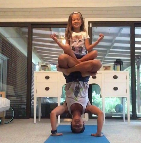 Photo (Doing Yoga w her Daughte)rn.jpg