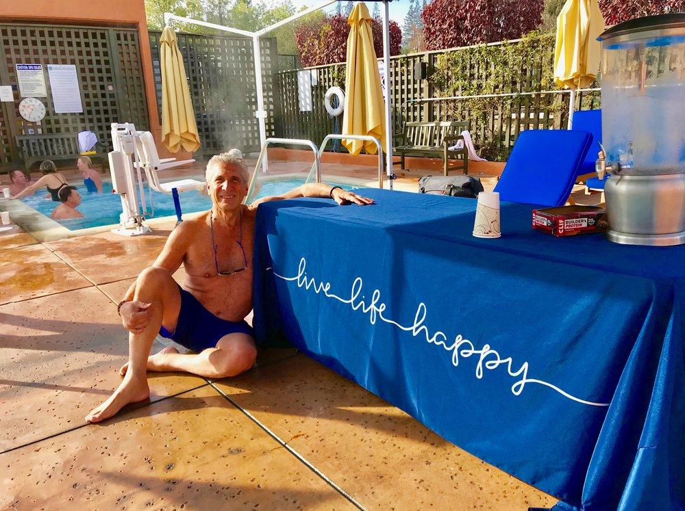 Dennis & Live Life Happy sign at pool.jpg*.jpg
