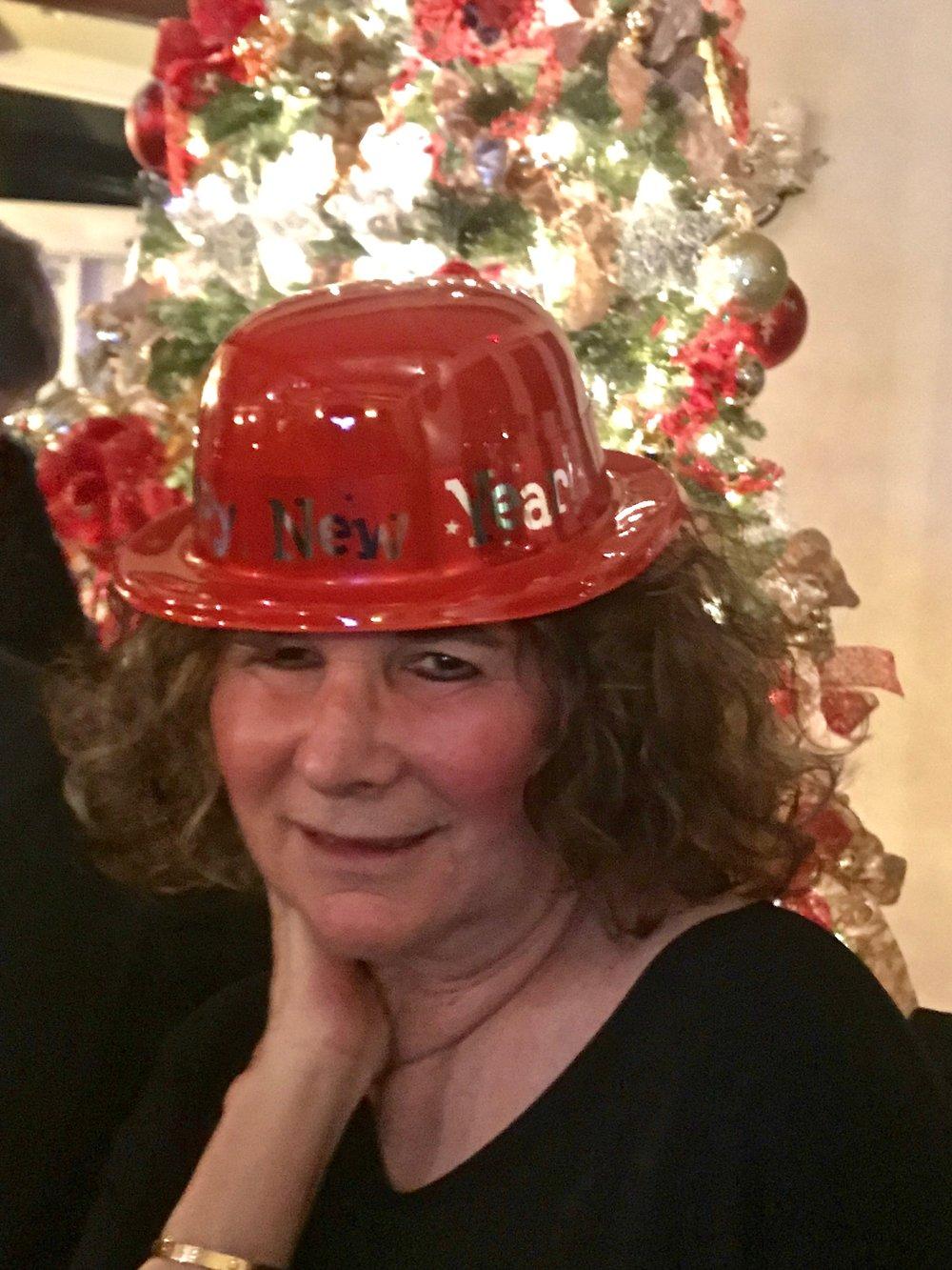 Marleen w Red NY Hat.jpg