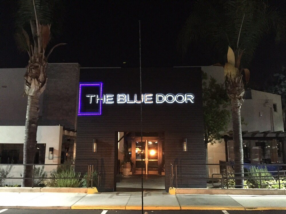 The Blue Door Sign at night.jpg