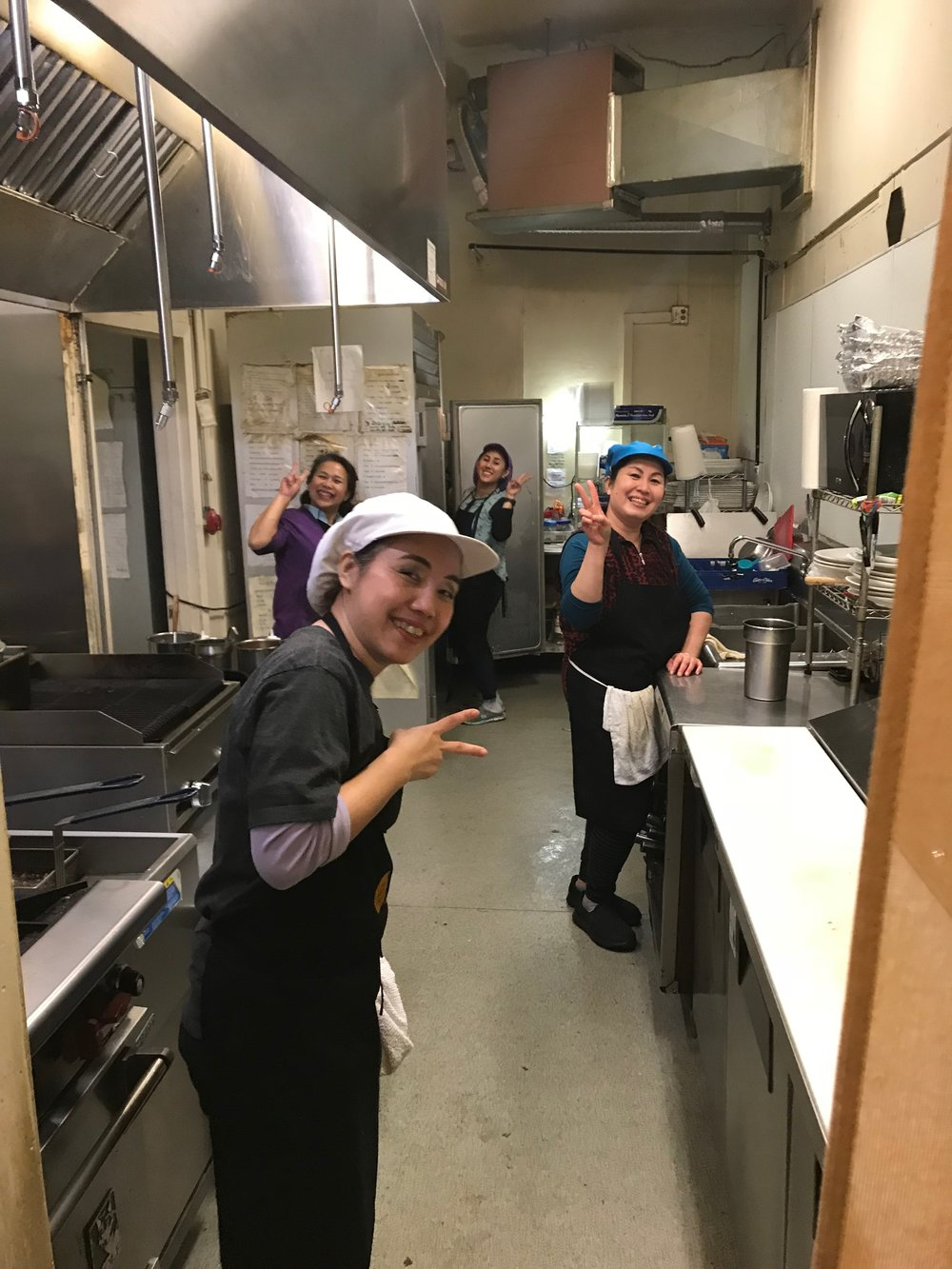 Joyful cooks flashing a peace sign.jpg*.jpg