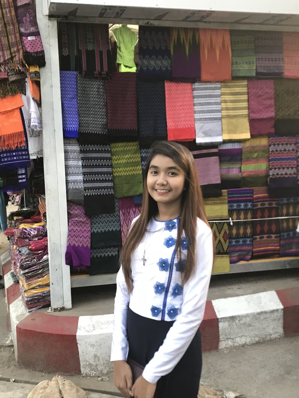 Michelle in front of fabric colors market.jpg*.jpg