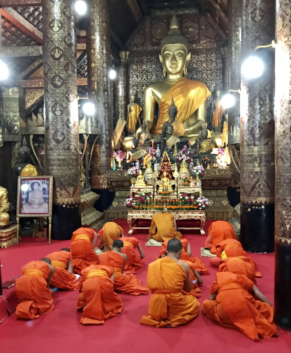 Monks bowing Buddha after chants.jpg