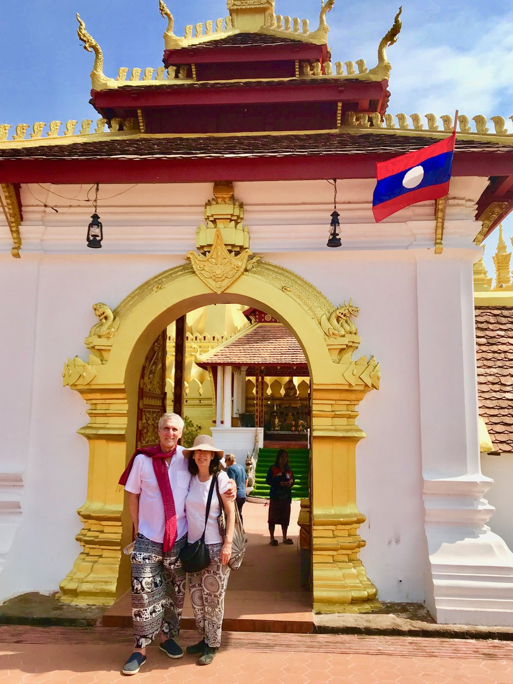 Den and Ceil front of Wat That Luang.jpg*.jpg