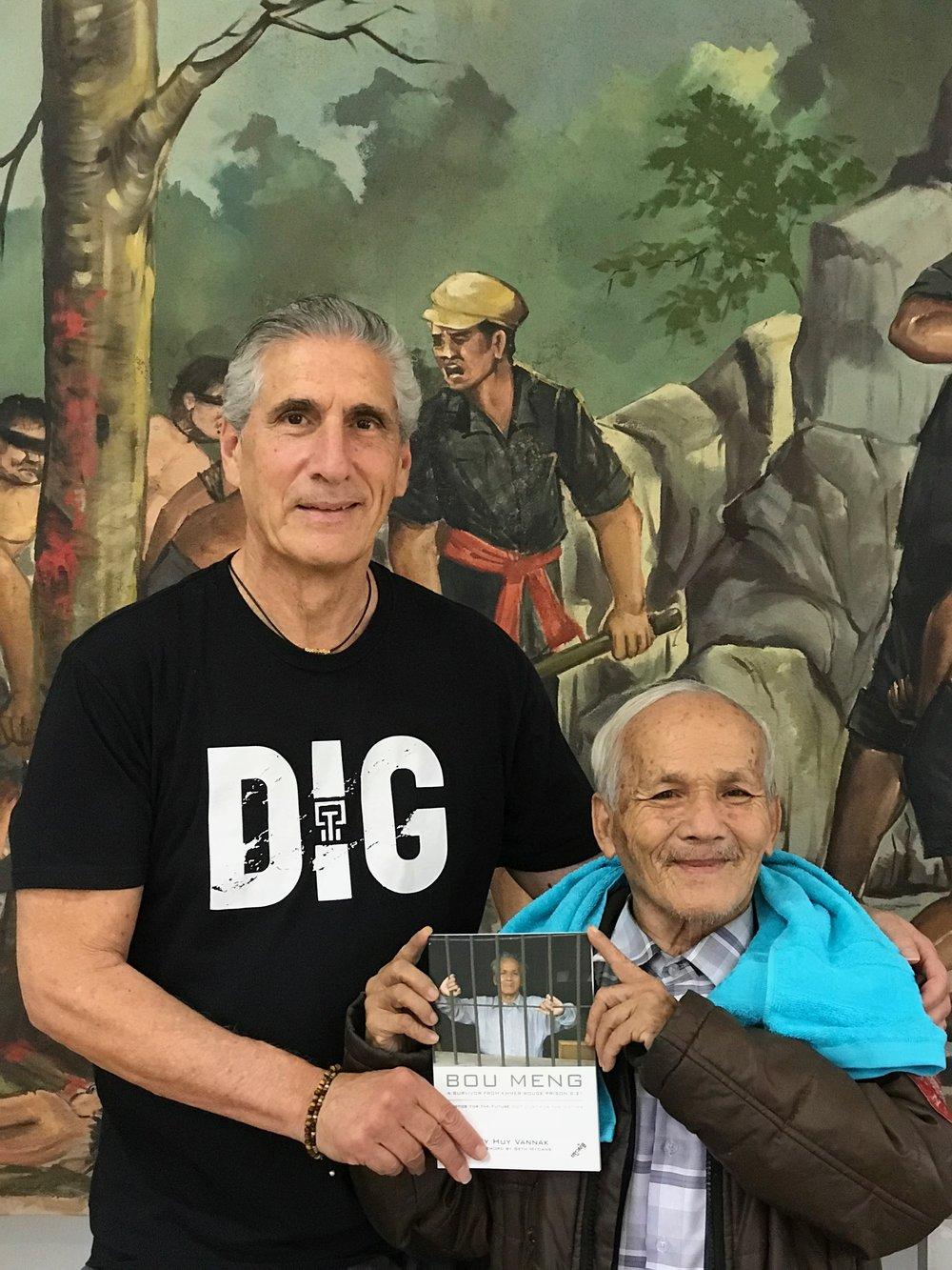 Dennis with Bou Meng survivor.jpg