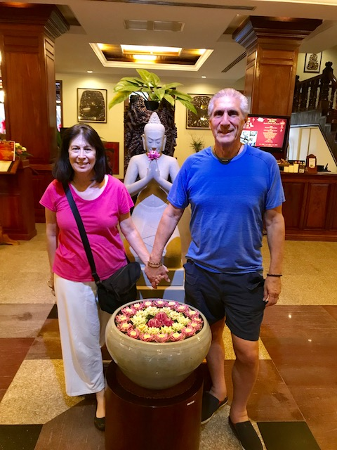 Ceil and Dennis with BUddha & Vase of Lotus flowers.jpg*.jpg