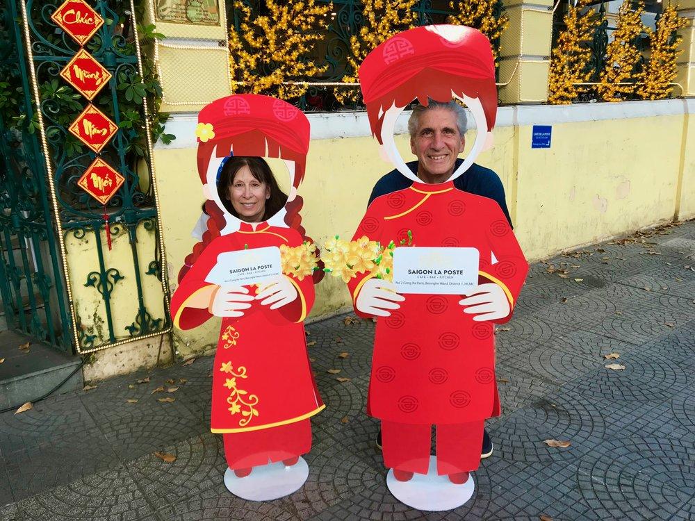 Ceil & Den in red cuthouts Saigon La Poste.jpg*.jpg