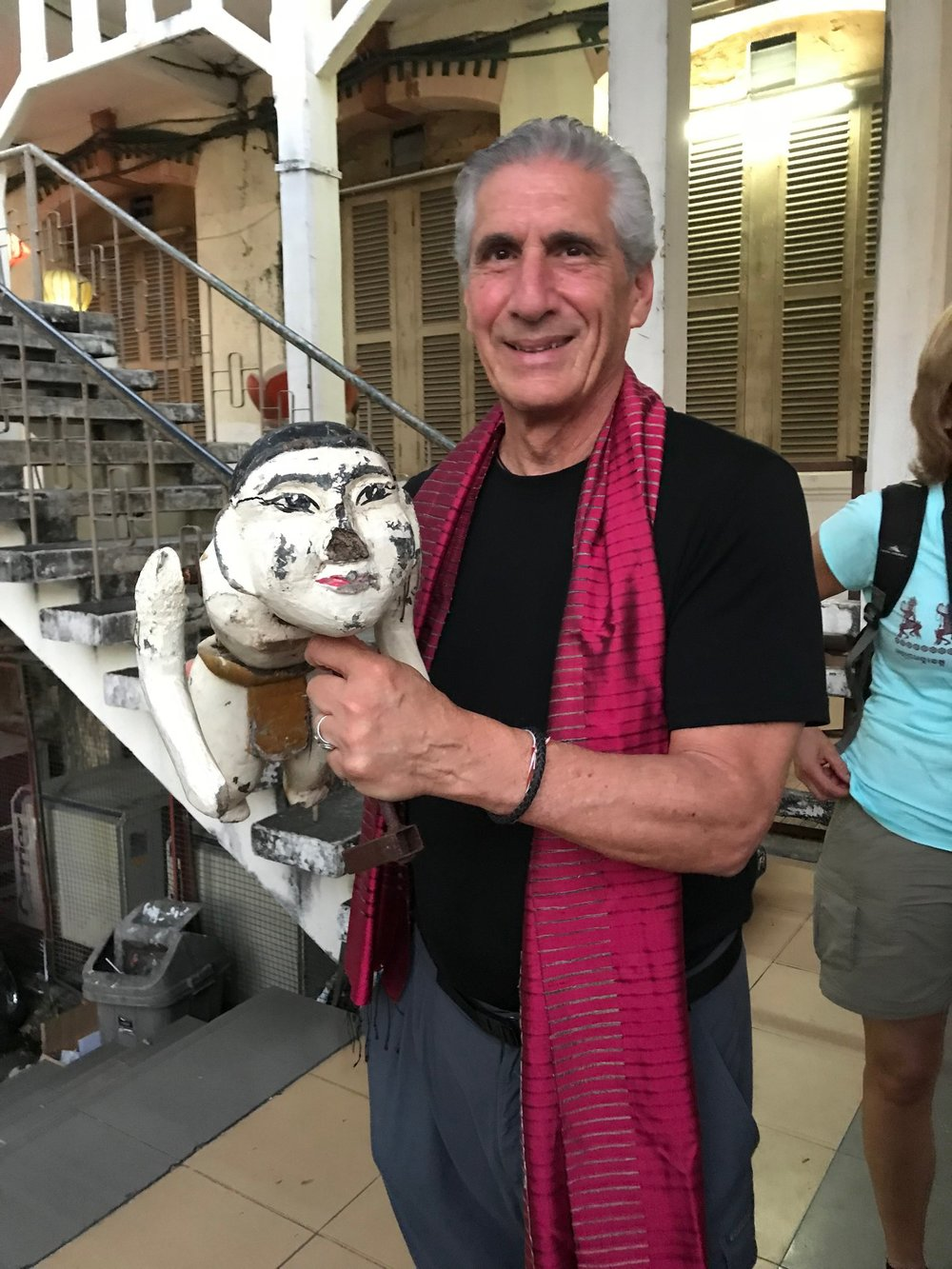 Den w red scarf holding puppet after show.jpg