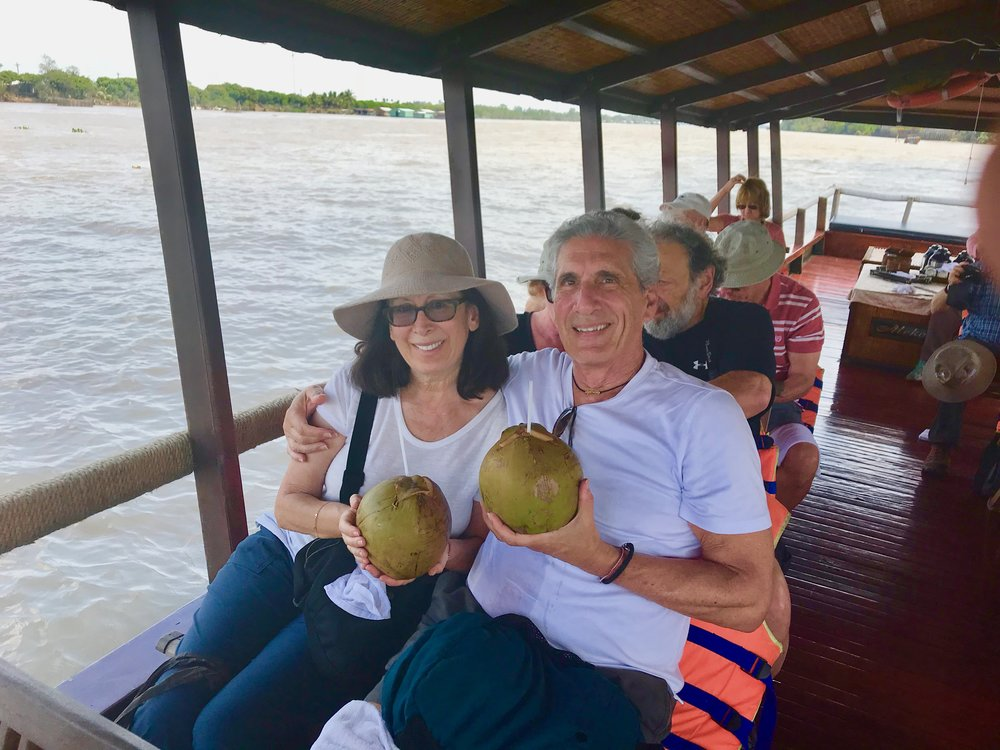 Cecile & Me drinking coconut on Paddle boat on Mekong.jpg*.jpg