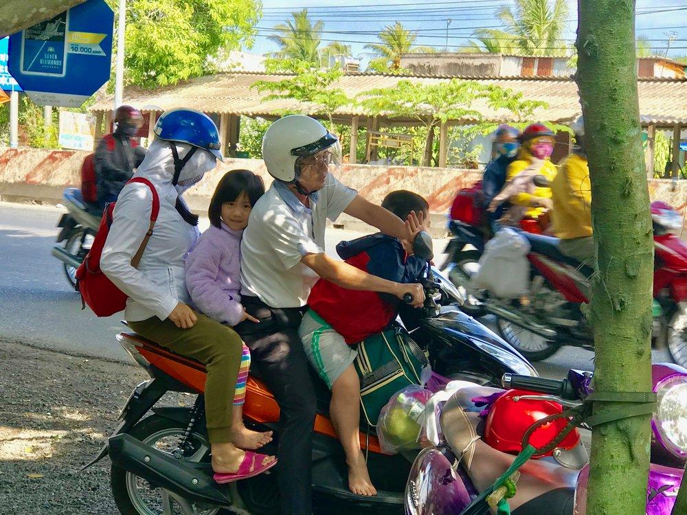 Family 4 on Motorbike Cafe Sake.jpg