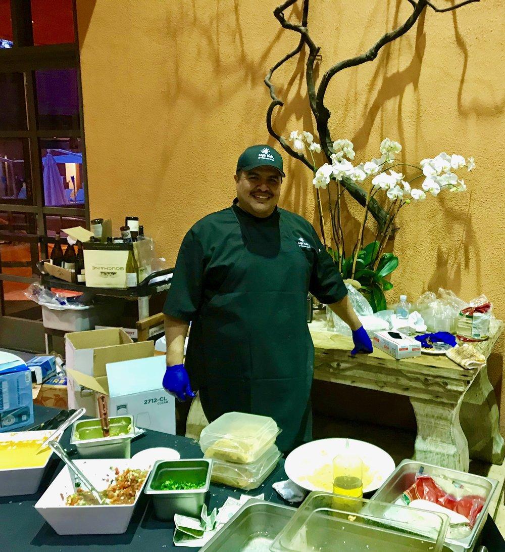 Juan poses over Taco fixings.jpg
