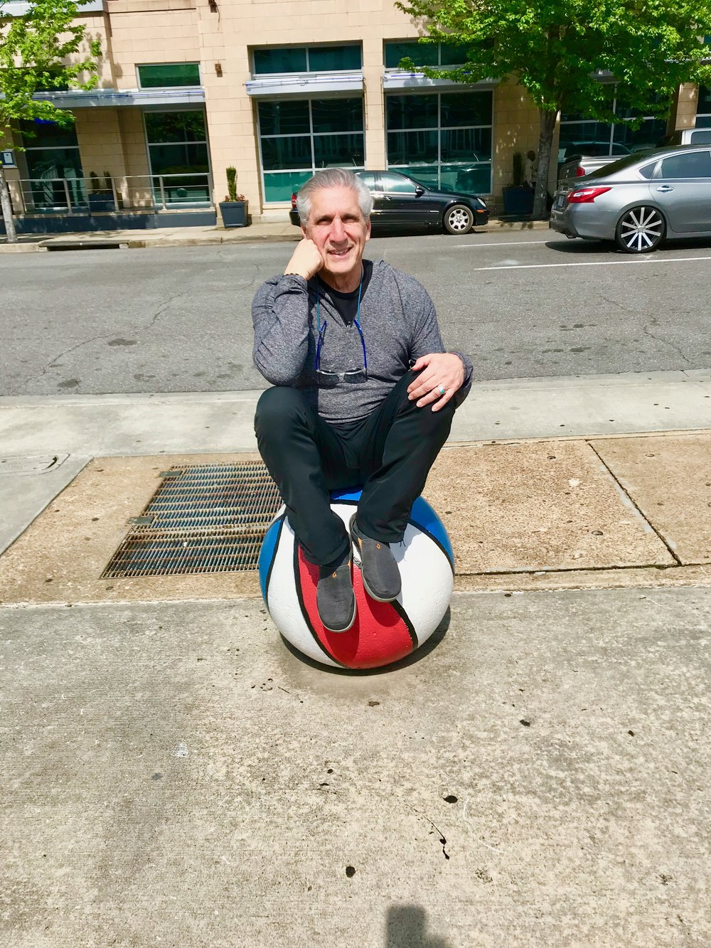 Sitting on basketball The Thinker.jpg