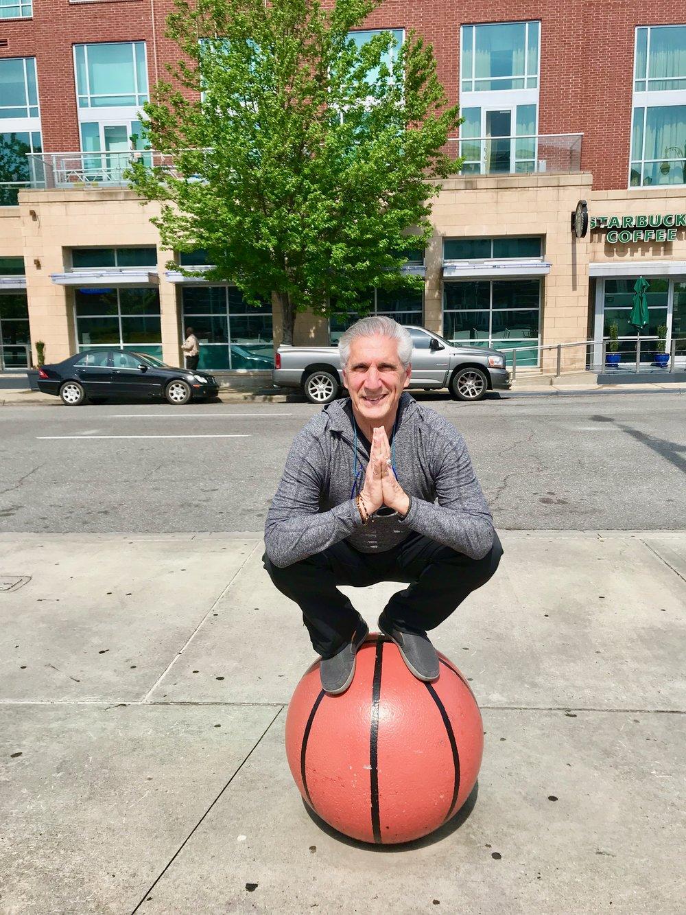 Squat Pose in Namaste on Basketball.jpg