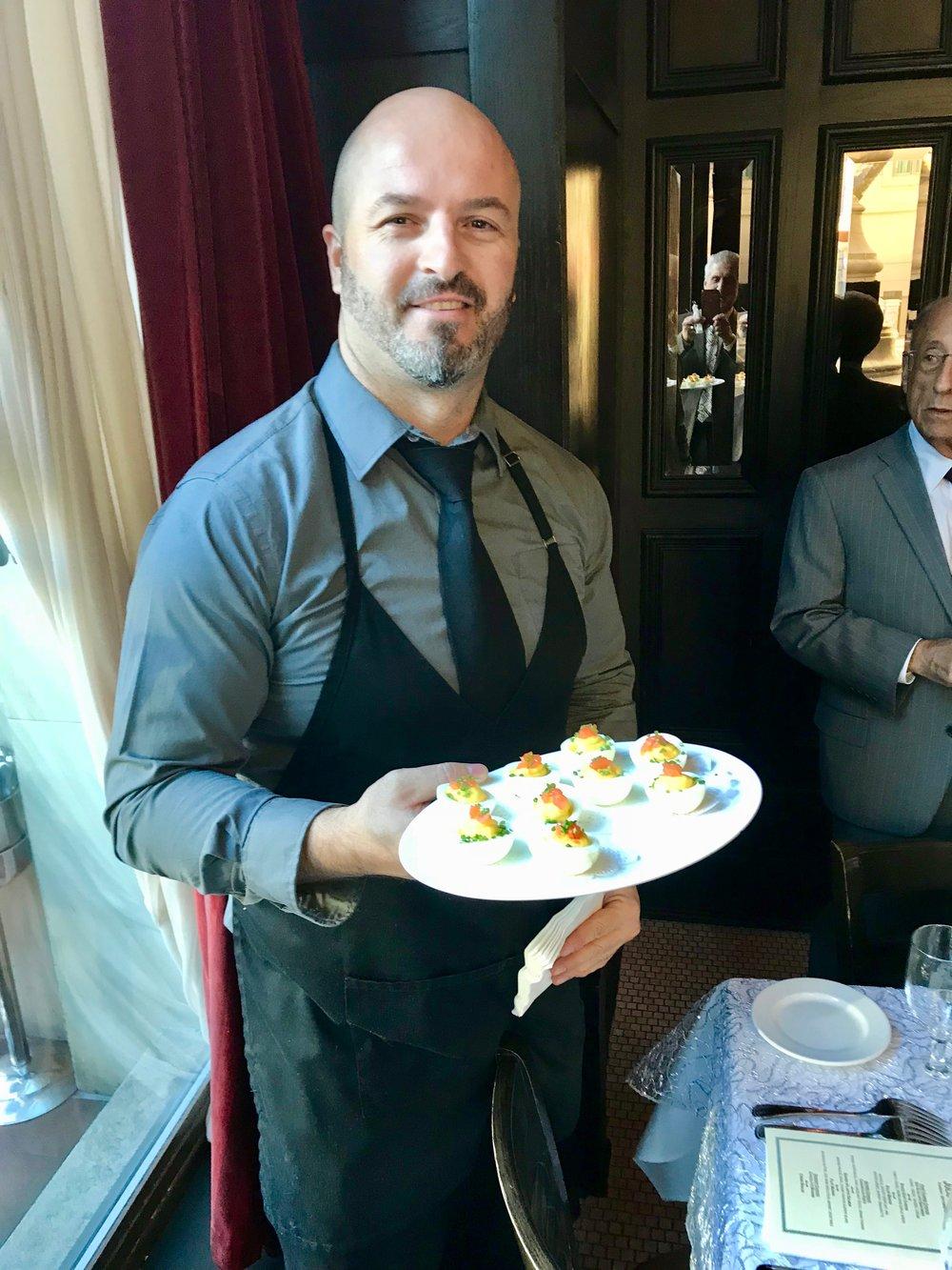 Waiter w platter deviled eggs.jpg