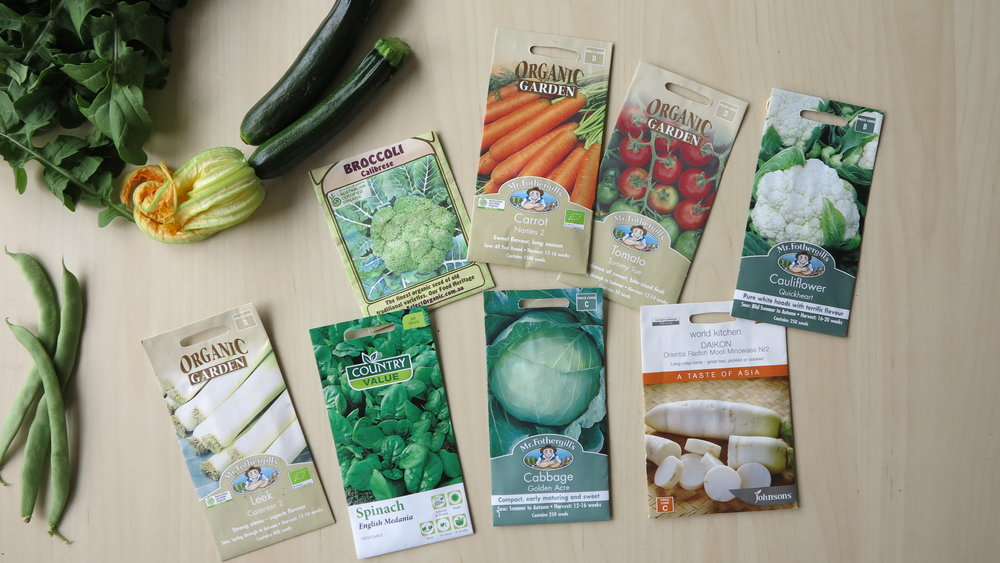My recent garden harvest to the left (beans, rocket & zucchinis)and my latest seed haul ready for planting in the new patch!