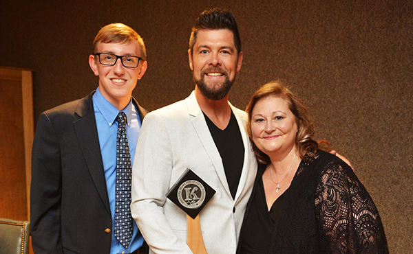 Avery Bradshaw (Executive Director, Kentucky Music Hall of Fame & Museum), Jason Crabb, and Deborah Evans Price pose backstage during the 2018 Kentucky Music Hall of Fame Induction Ceremony on Friday, May 11, 2018 in Mount Vernon, KY at the Renfro Valley Entertainment Center. Photo courtesy Conduit Media