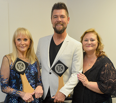 Jackie DeShannon (fellow 2018 inductee), Jason Crabb, and Deborah Evans Price pose backstage during the 2018 Kentucky Music Hall of Fame Induction Ceremony on Friday, May 11, 2018 in Mount Vernon, KY at the Renfro Valley Entertainment Center. Photo courtesy Conduit Media